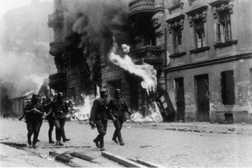 Photo of German troops leveling Warsaw Ghetto.